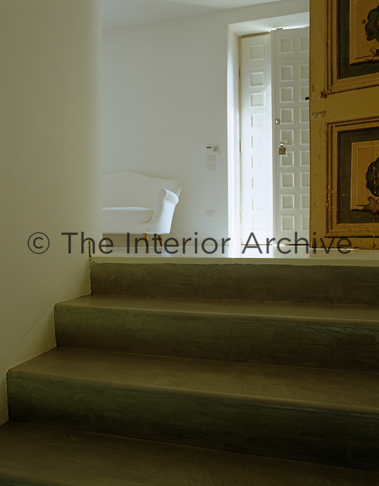 Concrete steps lead up the main entrance hall the floors of which are made of poured resin