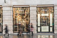 People shopping in Sloane Square, walking past the Hugo Boss shop, London, England