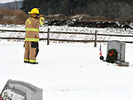 Ellington firefighter Tom Adams, salutes the grave of Peter Skipper, a Marine veteran and a past member of the Ellington Volunteer Fire Department, during a Wreaths Across America event in Ellington, Saturday, December, 16, 2017, at the Ellington Center Cemetery in Ellington.The local event was sponsored by the Ellington Fire Department who places more than 100 wreaths on the graves of veterans. (Jim Michaud / Journal Inquirer)
