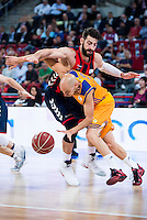 Baskonia's player Tornike Shengelia and Herbalife Gran Canaria's player Albert Oliver during the match of the semifinals of Supercopa of La Liga Endesa Madrid. September 23, Spain. 2016. (ALTERPHOTOS/BorjaB.Hojas)