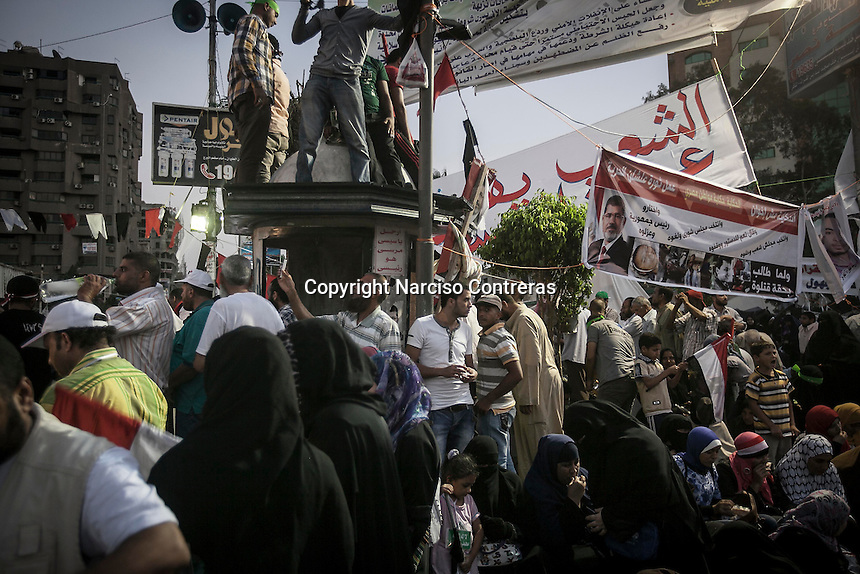 In this Friday, Jul. 12, 2013 photo, Muslim supporters of the ousted president Mohammed Morsi gather in the streets nearby Al Rabaa mosque to demostrate in Nasr City, Cairo. (Photo/Narciso Contreras).