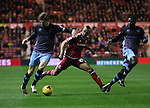 Glenn Loovens of Sheffield Wednesday taking the ball from Emilio Nsue of Middlesbrough - Sky Bet Championship - Middlesbrough vs Sheffield Wednesday - Riverside Stadium - Middlesbrough - England - 28th of December 2015 - Picture Jamie Tyerman/Sportimage