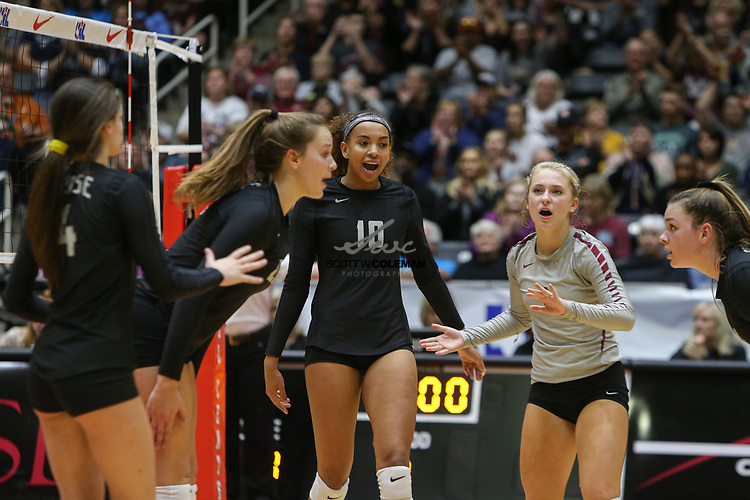 The Rouse Raiders celebrate a point during the Class 5A high school volleyball state final between Rouse High School and Prosper High School at Curtis Culwell Center in Garland, Texas, on November 18, 2017. Prosper won the match in five sets, (25-18, 21-25, 18-25, 25, 23, 16-14) to win the 5A state championship.