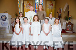 Pupils from Scoil Mhichíl Naofa, Ballinskelligs who made their First Holy Communion in the church of St Michael the Archangel on Saturday pictured here front l-r; Lucy Ní Ghiní, Alison Nic an Ghaill, Keita Taranda, Holly Ní Leidhin, Maebh Nic an tSionaigh, back l-r; Hannah Ní Dhuibhir(server), Fr David Gunn, Síle Ni Chonaill agus Séamus Ó Laoi.