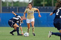 27 August 2011:  FIU's Marie Egan (13) gets past Akron's Kelly DeNiro (10) in the first half as the FIU Golden Panthers defeated the University of Arkon Zips, 1-0, at University Park Stadium in Miami, Florida.