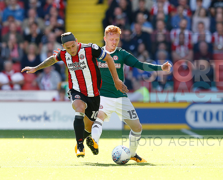 Billy Sharp of Sheffield Utd tussles with Ryan Woods of Brentford during the English Championship League match at Bramall Lane Stadium, Sheffield. Picture date: August 5th 2017. Pic credit should read: Simon Bellis/Sportimage