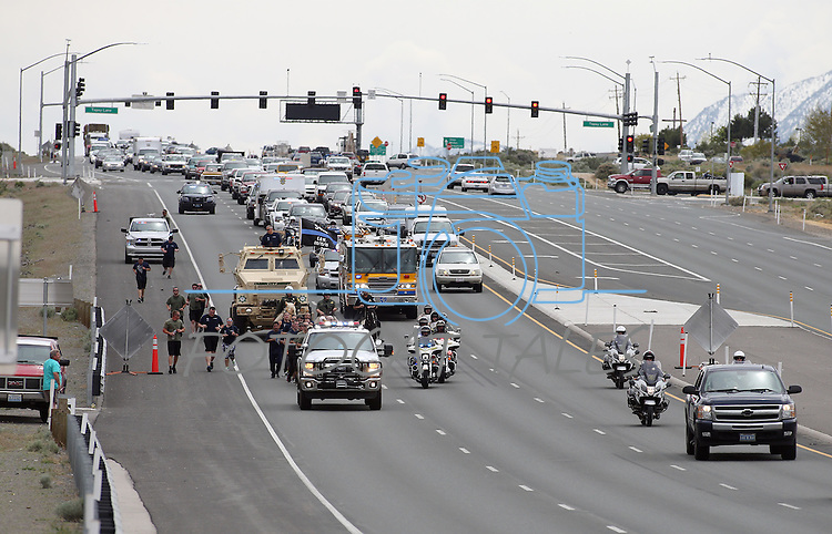 The Nevada Law Enforcement Officers Memorial Run arrives in Carson City, Nev. on Wednesday, May 4, 2016. A baton containing the 129 names of Nevada's fallen officers travels from Las Vegas to Carson City each year for the annual ceremony which will be Thursday at the Capitol at noon. <br /> Photo by Cathleen Allison/Nevada Photo Source