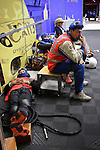 Night is hard for everyone, mechanics are trying to take some rest between two relays. Typical scene on Endurance Races, Sunday, August 3, 2008, in Spa-Francorchamps, Belgium. (Valentin Bianchi/pressphotointl.com)