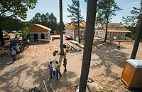 NWA Democrat-Gazette/CHARLIE KAIJO Volunteers construct homes, Friday, June 8, 2018 on Passion Play Road, across the street from the Washington Regional clinic in Eureka Springs. <br />