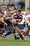 Siale Piutau is taken by Nili Latu during the Air NZ Cup rugby game between Bay of Plenty & Counties Manukau played at Blue Chip Stadium, Mt Maunganui on 16th of September, 2006. Bay of Plenty won 38 - 11.