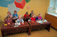 Russian pre-school students wearing headphones in English class. Saratov, Russia.