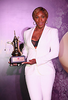 SINGAPORE - OCTOBER 25:  Serena Williams of the United States poses for a photograph with her WTA Year End World Number One Singles Trophy sponsored by Dubai Duty Free at the WTA Year End Gala Party at the Marina Bay Sands Hotel during the BNP Paribas WTA Finals at Singapore Sports Hub on October 25, 2014 in Singapore.  (Photo by Clive Brunskill/Getty Images)
