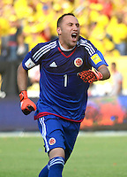 BARRANQUILLA - COLOMBIA -08-10-2015: David Ospina arquero de Colombia celebra un gol anotado por Teofilo Gutierrez (fuera de cuadro) a Perú durante partido válido por la clasificatoria a la Copa Mundo FIFA 2018 Rusia jugado en el estadio Metropolitano Roberto Melendez en Barranquilla. / David Ospina goalkeepre of Colombia celebrates a goal scored by Teofilo Gutierrez (out the frame) to Peru during match valid for the 2018 FIFA World Cup Russia Qualifier played at Metropolitan stadium Roberto Melendez in Barranquilla. Photo: VizzorImage / Alfonso Cervantes / Str