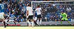 John Baird (L) shoots to score for Falkirk