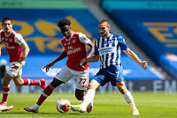 20th June 2020, American Express Stadium, Brighton, Sussex, England; Premier League football, Brighton versus Arsenal ;  Arsenals Bukayo Saka challenges Brighton and Hove Albions Neal Maupay