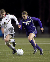 "University of Washington forward Alex Webber (13) dribbles as Boston College defender Alyssa Pember (6) defends. In overtime, Boston College defeated University of Washington, 1-0, in NCAA tournament ""Elite 8"" match at Newton Soccer Field, Newton, MA, on November 27, 2010."