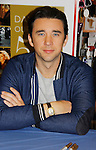 """Cast of Days Of Our Lives - Billy Flynn signs book """"Days Of Our Lives 50 Years"""" by Greg Meng - author & co-executive producer on October 27, 2015 at Books & Greetings, Northvale, New Jersey. (Photo by Sue Coflin/Max Photos)"""