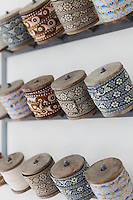 Reels of woven ribbon in Kally Ellis's kitchen. They make a beuatiful display but are also used for her florist work
