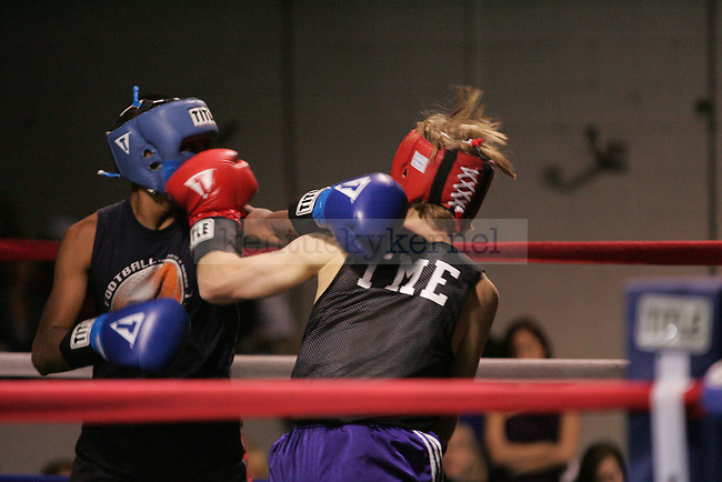 Rick Guha (L) of Phi Sig and Charlie Hunt (R) of Sigma Chi punch each other during their bout at The Main Event, where proceeds benefitted The Huntsman Cancer Institute and The Ronald McDonald House in Lexington, Ky. on 11/11/11. Photo by Quianna Lige | Staff