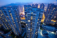 An overview of Minxin Jiayuan, a flagship low-income housing in Chongqing city. The Chinese government plans to move 250 million rural residents into urban areas over the coming dozen years though it is unclear whether people want to move and where the money for this project will come from. Further urbanisation is meant to drive up consumption to counterbalance an export orientated economy and end subsistence farming but the drive to get people off the land is causing tens of thousands of protests each year. /Felix Features