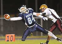 Spartans tight end Adam Schluter makes a one-handed grab past defender Nick Fahrney to set up a Spartans' touchdown, as McFarland plays Madison Edgewood in the first round of the WIAA Division 3 football playoffs at McFarland High School on Tuesday, 10/26/10