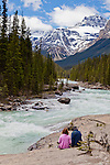 The Icefields Parkway stretches 230 km (142 miles) between Lake Louise and the town of Jasper and travels through the heart of the Canadian Rockies.  The highway parallels the Main Ranges of the Canadian Rockies within Banff and Jasper National Parks.  The peaks of the mountains visible from the highway can reach an altitude of 3300 meters (11,000 feet).  Many glacially fed streams and lakes can be seen and visited along the way.  Pictured here is Mistaya Canyon.  Mistaya Canyon is a canyon in the western part of the Alberta province of Canada. It is formed by the Mistaya River. Tourists who are visiting Banff National Park often visit it because of its distinctive curvy canyon walls and because it is easy to access, being just off the Icefields Parkway. The 0.5 km trail to the canyon is located at a large parking area on the west side of the Parkway, part way up the long hill south of the North Saskatchewan River.