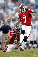 Tampa Bay Buccaneer kicker Martin Gramatica (#7) and his holder Tom Tupa watch a kick fly toward the goal post during an NFL preseason game in Jacksonville, FL on Friday, August 15, 2002.  Gramatica kicked two field goals as Tampa bay won the game 20 to 0. (Photo by Brian Cleary/ www.bcpix.com )