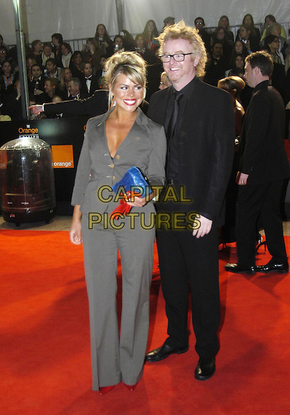 BILLIE PIPER & CHRIS EVANS.Bafta Awards - British Academy Awards at Odeon Leicester Square.15 February 2004.full length, full-length, celebrity couple, grey, gray suit, black suit.www.capitalpictures.com.sales@capitalpictures.com.©Capital Pictures