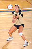 11 September 2011:  FIU outside hitter Jovana Bjelica (16) returns the ball in the second set as the FIU Golden Panthers defeated the Florida A&M University Rattlers, 3-0 (25-10, 25-23, 26-24), at U.S Century Bank Arena in Miami, Florida.