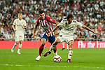 Real Madrid's Dani Ceballos and Atletico de Madrid's Angel Martin Correa during La Liga match between Real Madrid and Atletico de Madrid at Santiago Bernabeu Stadium in Madrid, Spain. September 29, 2018. (ALTERPHOTOS/A. Perez Meca)