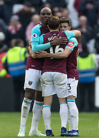 (l-r)  Angelo Ogbonna, Mark Noble & Aaron Cresswell of West Ham United celebrate at full time during the EPL - Premier League match between West Ham United and Southampton at the Olympic Park, London, England on 31 March 2018. Photo by Andy Rowland.