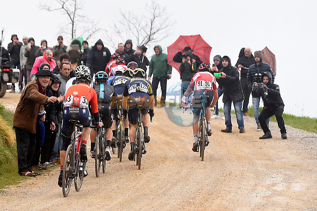 Riders climb gravel sector 8 Monte Santa Maria during the 2017 Strade Bianche running 175km from Siena to Siena, Tuscany, Italy 4th March 2017.<br /> Picture: La Presse/Fabio Ferrari | Newsfile<br /> <br /> <br /> All photos usage must carry mandatory copyright credit (&copy; Newsfile | La Presse)