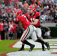 ATHENS, GA - NOVEMBER 23: D'Andre Swift #7 of the Georgia Bulldogs receives the ball from Jake Fromm #11 in the Georgia end zone. during a game between Texas A