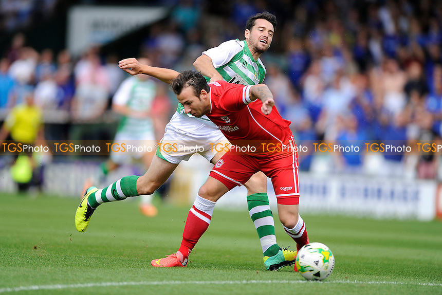 Adam Le Fondre of Cardiff City is fouled by Brendan Moloney of Yeovil Town - Yeovil Town vs Cardiff City  - Pre-Season Friendly Football Match at Huish Park, Yeovil, Somerset - 27/07/14 - MANDATORY CREDIT: Denis Murphy/TGSPHOTO - Self billing applies where appropriate - contact@tgsphoto.co.uk - NO UNPAID USE