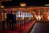 Gem Palace director Siddharth Kasliwal (4th from left) and other guests admire Argyle pink diamond jewellery by Nirav Modi at the OzFest Gala Dinner in the Jaipur City Palace, in Rajasthan, India on 10 January 2013. Photo by Suzanne Lee