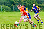 Valentia's Paul O'Connor under pressure from Ballymacelligott's Aidan Breen manages to clear his lines.