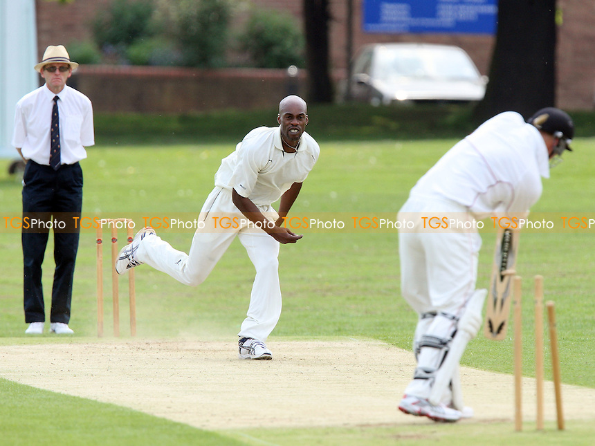 Ex-England cricketer Chris Lewis in bowling action for Ilford as he claims the wicket of C Sains, clean bowled - Hornchurch CC vs Ilford CC - Shepherd Neame Essex Cricket League Division One at Harrow Lodge Park, Hornchurch Road, Hornchurch, Essex - 10/05/08 - MANDATORY CREDIT: Gavin Ellis/TGSPHOTO. Self-Billing applies where appropriate. NO UNPAID USE. Tel: 0845 094 6026