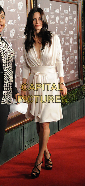 "COURTENEY COX ARQUETTE .at The 2nd Annual Art of Elysium Black Tie Charity Gala ""Heaven"" held at The Vibiana in Los Angeles, California, USA,  January 10th 2009.                                                                     .full length white long sleeved dress black shoes sandals wrap tied belt belted .CAP/DVS.©Debbie VanStory/Capital Pictures"