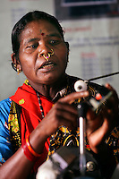 Grandmother Pulka Wadeka trains people how to make a solar lamp at a workshop in the village Tinginapu. Pulka is one of four women from the village who has been trained in solar powered engineering by The Orissa Tribal Empowerment and Livelihoods Programme (OTELP), an organisation funded by DFID (Department for International Development) and run with the state government of Orissa. The Orissa Tribal Women's Barefoot Solar Engineers Association has now got a contract to build 3,000 solar-powered lanterns for schools and other institutions and is training other people in the community.