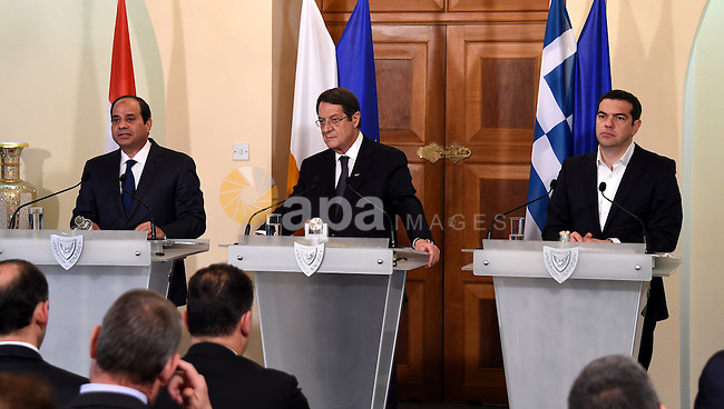 President of the Republic of Cyprus, Nikos Anastasiades (C), Egyptian President Abdel Fattah al-Sisi (L) and Greek Prime Minister Alexis Tsipras (R), attend their press conference in Nicosia, Cyprus 29 April 2015. Cyprus, Greece and Egypt are holding a follow-up Cyprus-Greece-Egypt tripartite economic relations meeting on shipping, tourism and energy in Nicosia aimed at establishing greater cooperation in the eastern Mediterranean. Photo by Egyptian Presidency