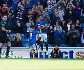9th September 2017, Ibrox Park, Glasgow, Scotland; Scottish Premier League football, Rangers versus Dundee; Rangers' Alfredo Morelos is congratulated after scoring by James Tavernier and Ryan Jack after scoring for 4-0