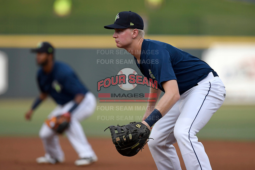 First baseman Dan Rizzie (5) of the Columbia Fireflies plays defense in a game against the Charleston RiverDogs on Monday, August 7, 2017, at Spirit Communications Park in Columbia, South Carolina. Behind him is Luis Carpio. Columbia won, 6-4. (Tom Priddy/Four Seam Images)