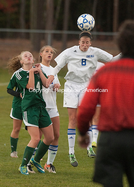 BURLINGTON,  CT-110716JS17- Lewis Mills' Corinne Morrow  (8) heads the ball  in front of Griswold's Gabrielle Christie (14)  during their first round Class M tournament game Monday at Nassahegan Field in Burlington. . <br /> Jim Shannon Republican American