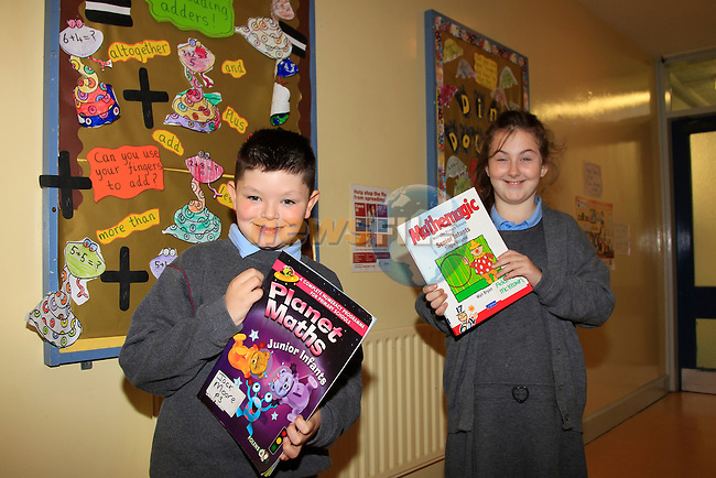 Jack Moore and Angel Hughes with there math books for math week in St Itas School.<br /> Picture: Fran Caffrey www.newsfile.ie