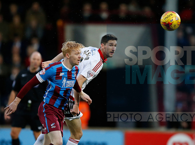 Chris Basham of Sheffield Utd stoops to win the ball - English League One - Scunthorpe Utd vs Sheffield Utd - Glandford Park Stadium - Scunthorpe - England - 19th December 2015 - Pic Simon Bellis/Sportimage