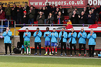 Dagenham management and substitutes on the touchline during a minute of applause in memory of Jodie Chesney during Dagenham & Redbridge vs Bromley, Vanarama National League Football at the Chigwell Construction Stadium on 9th March 2019