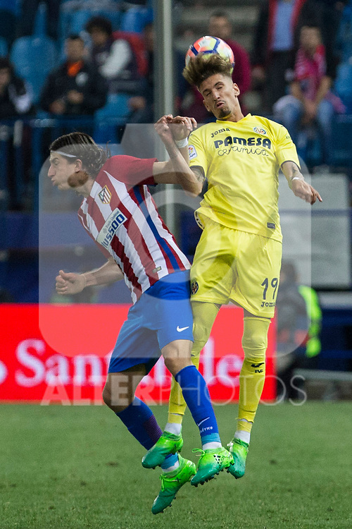 Filipe Luis of Atletico de Madrid battles for an aerial ball with Samu Castillejo of Villarreal during the match of La Liga between Atletico de Madrid and Villarreal at Vicente Calderon  Stadium  in Madrid, Spain. April 25, 2017. (ALTERPHOTOS/Rodrigo Jimenez)