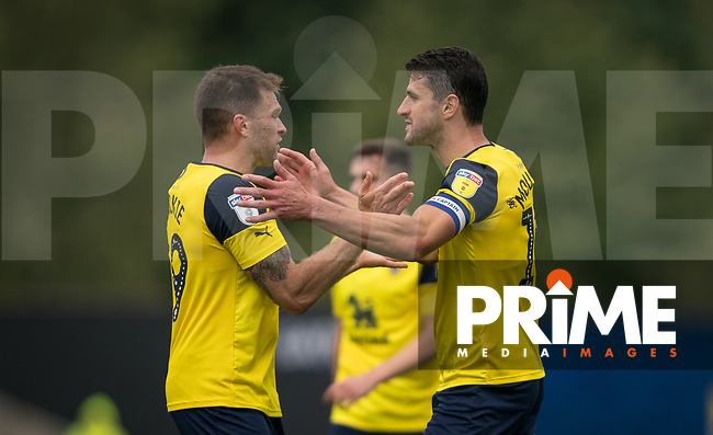 John Mousinho & Jamie Mackie of Oxford United during the Sky Bet League 1 match between Oxford United and Peterborough at the Kassam Stadium, Oxford, England on 10 August 2019. Photo by Andy Rowland.