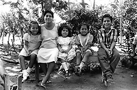 Family group attending a friend's birthday party. Community of Nueva Esperanza, El Salvador, 1999.