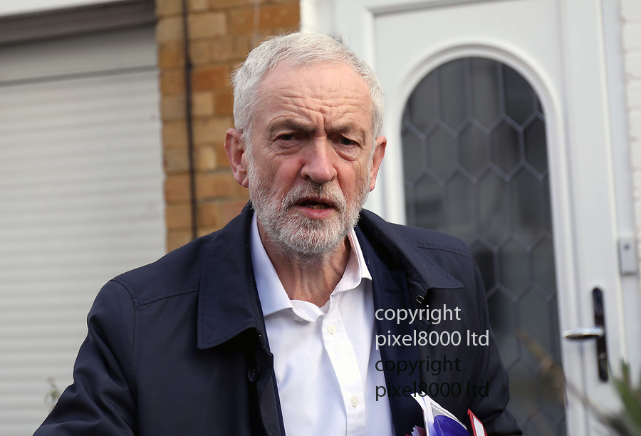 Pic shows: Jeremy Corbyn leaves home today 25.3.19<br /> He was carrying a tupperware box of what appeared to be home made cakes or fruit biscuits. <br /> Also carrying a confidential folder.<br /> <br /> He walked down his garden path after quickly removing his glasses past a large bag of garden clippings to his waiting car.<br /> <br /> His left eye looked a little swollen following reports he is having eye trouble.<br /> <br /> <br /> <br /> <br /> <br /> <br /> pic by Gavin Rodgers/Pixel8000